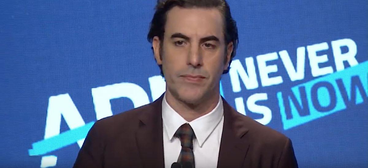 """Aho okerretik okerreko hitzak eskuineko lekuan.  """"Borat"""" -ek Facebook jipoitzen du eta Zuckerberg zigorra mehatxatzen du"""