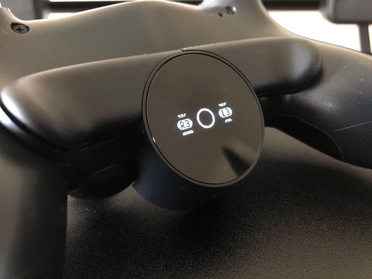 DualShock 4 Atzera botoiaren eranskinaren berrikuspena
